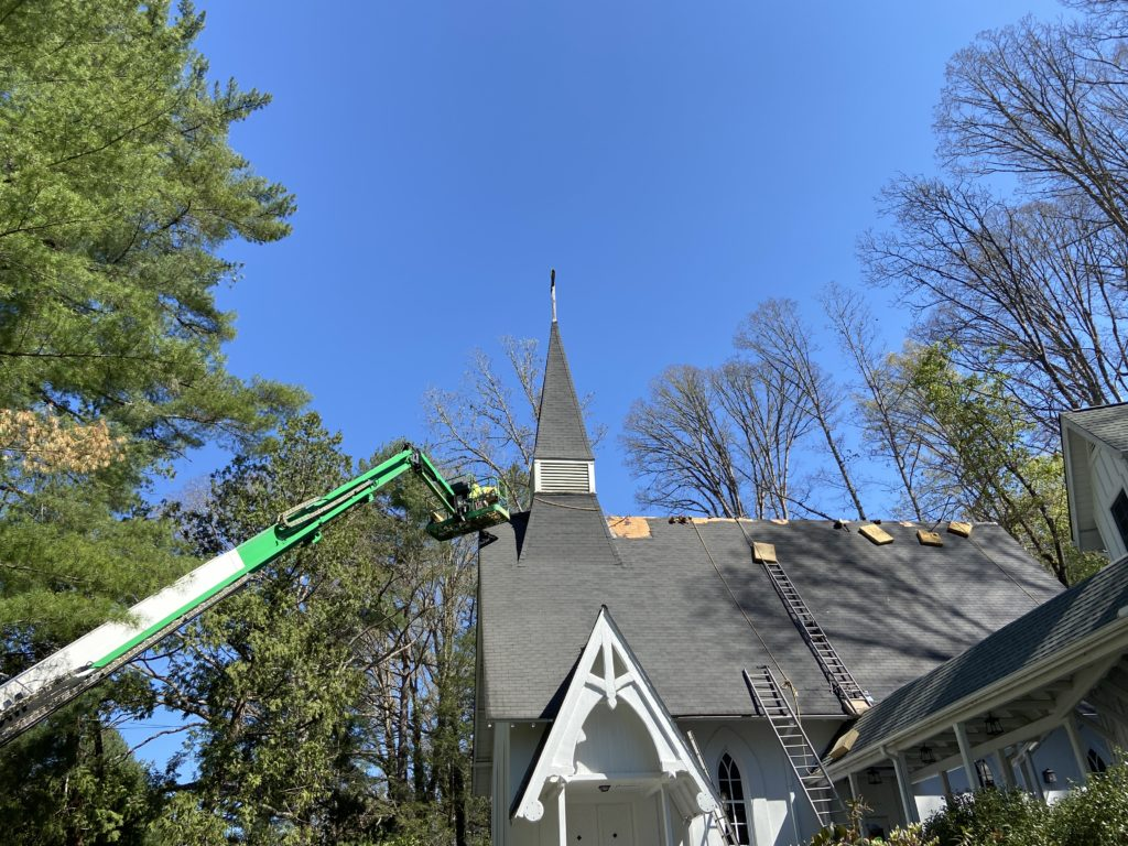 Removing shingles off Church