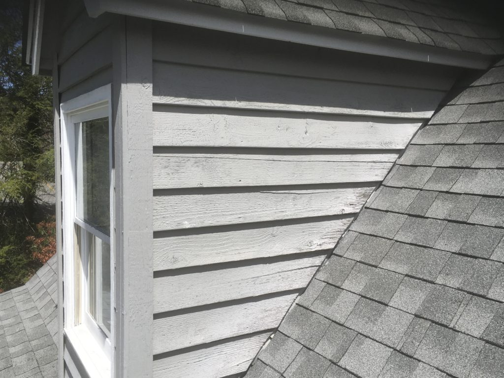 Cracked wood siding on dormer
