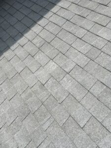 More pictures of old shingles that are worn out on a roof gray  color
